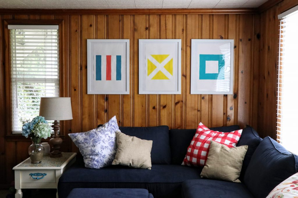 Nautical Flag Wall Art Project. Only two hours and basic art skills needed. Full tutorial on the blog.